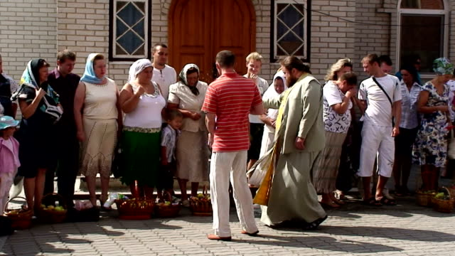 the priest of the church of sveti boris and gleb blesses the residents of borispol ukraine shot on august 1st 2011 - religiöse stätte stock-videos und b-roll-filmmaterial
