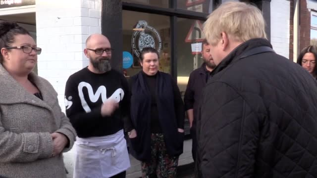 the prime minister meets with local business owners in stainforth and listens to local residents who have helped with the flooding in the village's... - number 7 stock videos & royalty-free footage