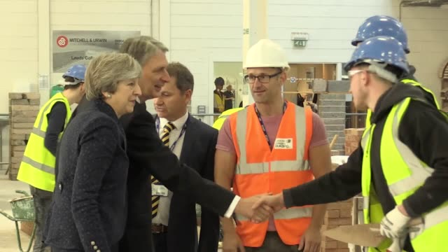 The Prime Minister Theresa May and Chancellor of the Exchequer Phillip Hammond visit Leeds College of Building Mrs May also discusses the Budget