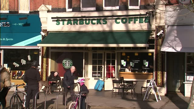 vídeos de stock, filmes e b-roll de the prime minister told business leaders this week to wake up and smell the coffee over paying their fair share of tax and it seems the company that... - starbucks
