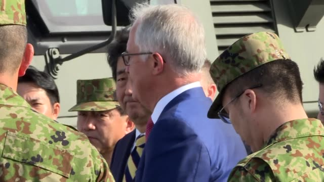 The prime ministers of Japan and Australia tour a military training camp outside Tokyo as the two countries seek to bolster defence ties in the face...