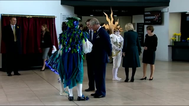 vídeos de stock e filmes b-roll de the prince of wales and duchess of cornwall visited the royal welsh college of music and drama perfomers in foyer dressed in various costumes walk... - xilofone
