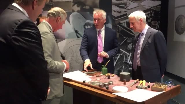 vídeos y material grabado en eventos de stock de the prince of wales has struck a commemorative coin to mark the duke of edinburgh's retirement from public duties. charles struck the coin during a... - royal mint