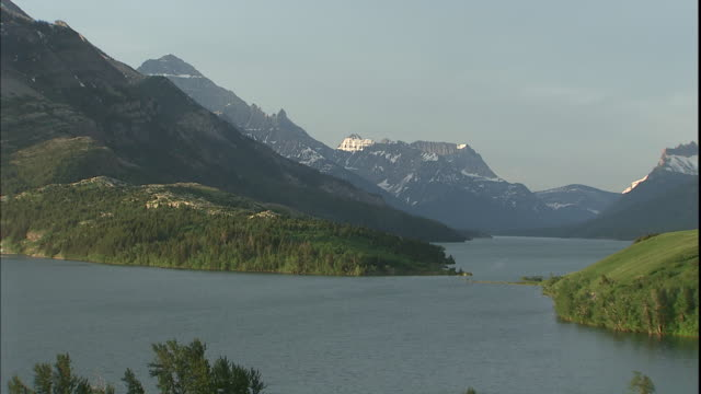 the prince of wales hotel occupies the shore of a lake in waterton lakes national park. - prince of wales stock videos & royalty-free footage