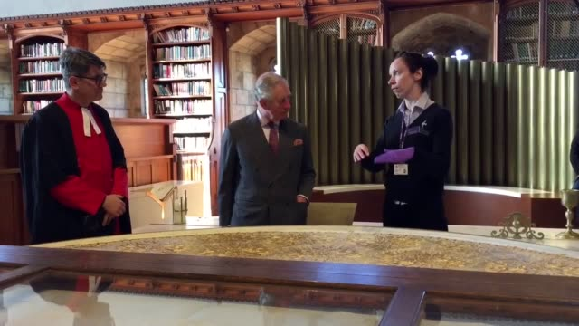 the prince of wales takes in the open treasure exhibition at durham cathedral on a royal visit to the city - イングランド ダラム点の映像素材/bロール