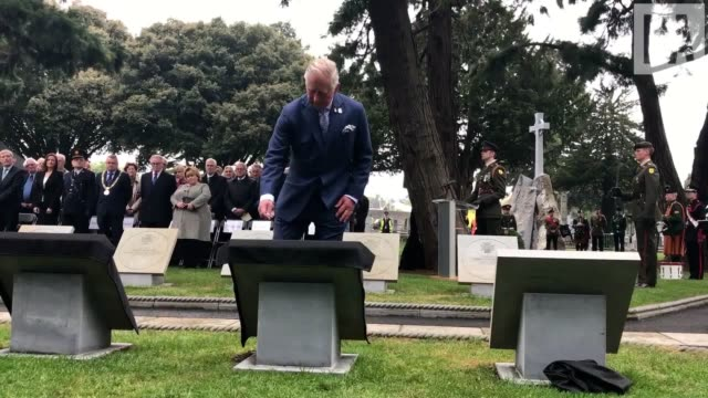 The Prince of Wales unveils a Victoria Cross paving stone in memory of Corporal John Cunningham at the Cross of Sacrifice in Dublin