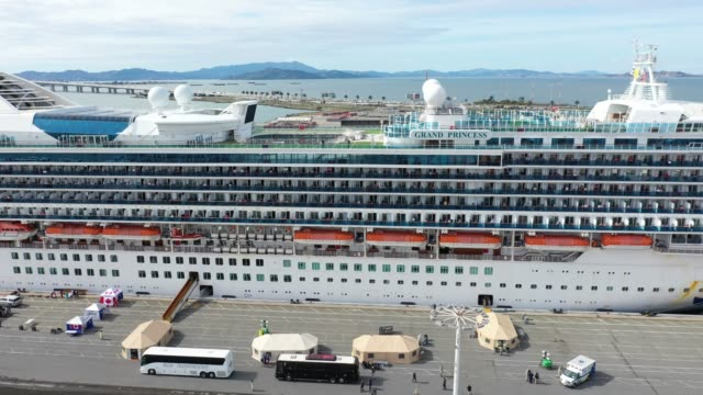 the princess cruises grand princess cruise sits docked in the port in oakland, ca on march 09, 2020 in oakland, california. - moored stock videos & royalty-free footage
