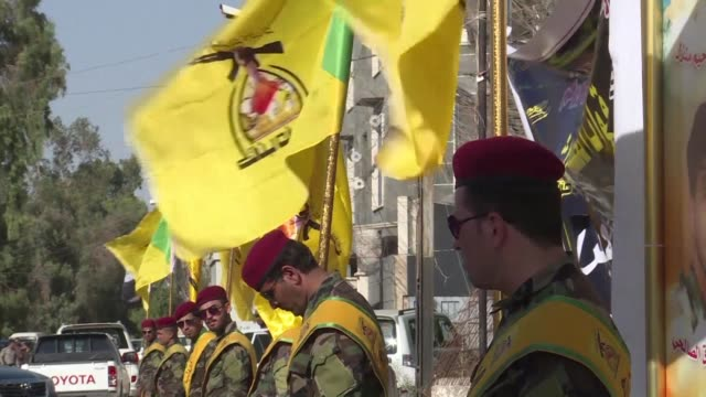vídeos de stock e filmes b-roll de the pro iran hezbollah brigades militia organises a mourning ceremony in baghdad for its fighters killed in an air raid just inside syria's border... - air raid