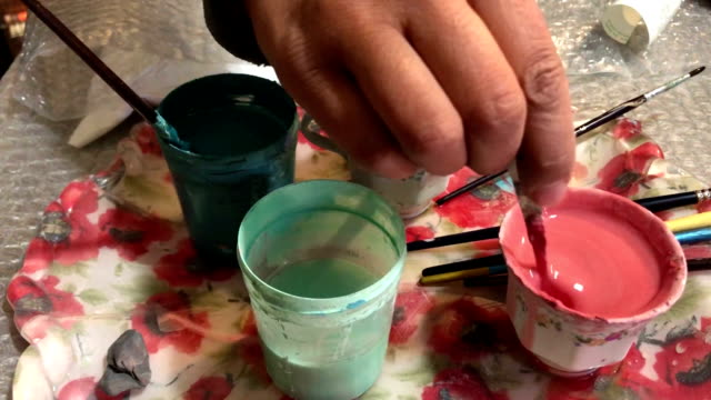 the process of mixing paint with a color - wood stain stock videos & royalty-free footage