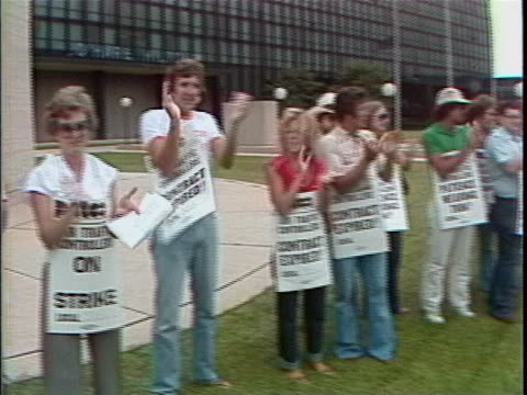 """the professional air traffic controllers organization workers are outside the o'hare airport striking. they are wearing signs that say, """"patco air... - united states and (politics or government) stock videos & royalty-free footage"""