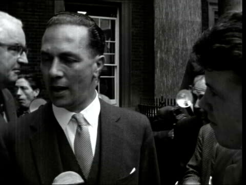 stockvideo's en b-roll-footage met cabinet meet:; 3: much press jostling enoch powell out - looking serious sir keith joseph and lord dilhorne out: sir joseph into sof: my resignation... - itv evening bulletin