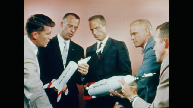 the project mercury astronauts stand together and discuss the model spacecraft in their hands - 1958 stock videos & royalty-free footage