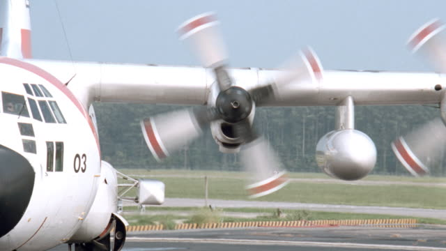 the propellers of a u.s. coast guard rescue plane slow to a stop as a crew begins to refuel. - propeller stock videos & royalty-free footage