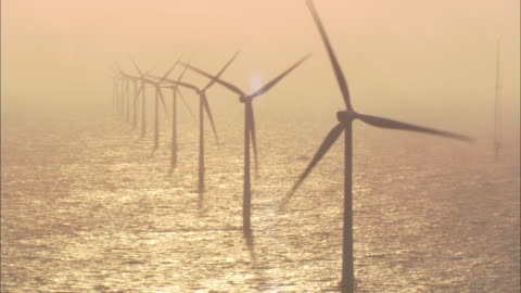 the propellers of wind turbines spin. - turbine stock videos & royalty-free footage