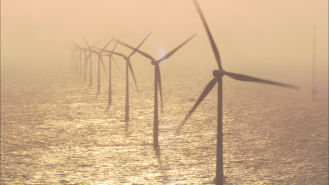 The propellers of wind turbines spin.