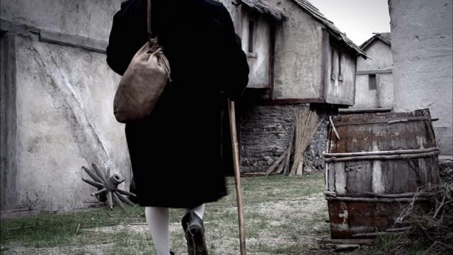 the prophet, nostradamus, walks through a village. - renaissance stock videos & royalty-free footage