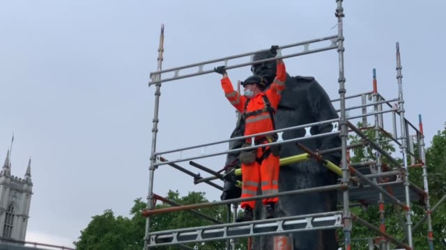 the protective boards placed around the statue of winston churchill in london's parliament square were removed on wednesday evening on june 17 ahead... - arranging stock videos & royalty-free footage