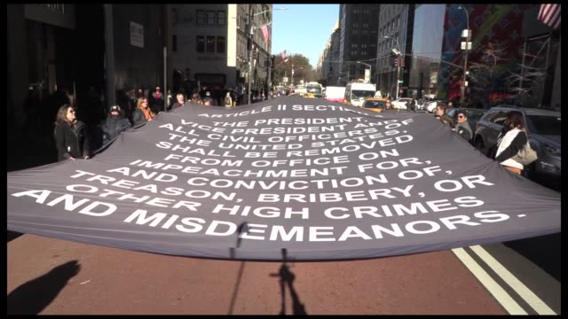 the protest group impeach trump unfurl 600 square foot banner with article ii, section iv of the us constitution articles of impeachment and read the... - fifth avenue stock videos & royalty-free footage