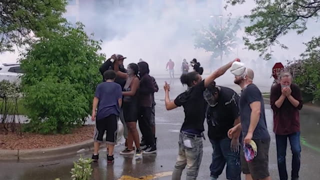 the protest included tense confrontations with police who responded with tear gas - george floyd stock videos & royalty-free footage