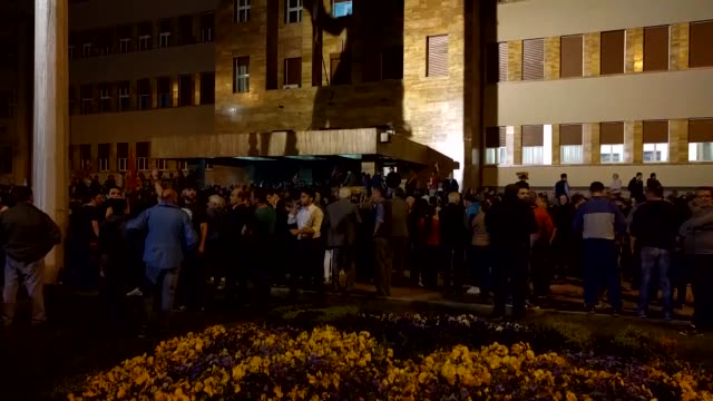 vídeos de stock, filmes e b-roll de the protesters demonstrating in front of the parliament building in the capital skopje storm the building after ethnic albanian talat xhaferi was... - república da macedônia