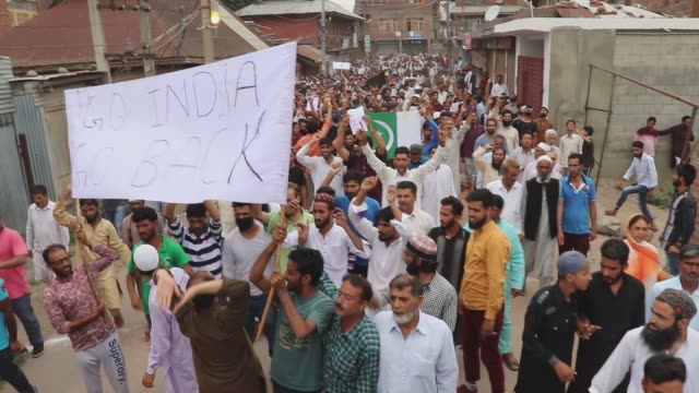 the protesters gathered by the thousands after friday prayers and set off from a mosque in the kashmiri capital of srinagar, chanting slogans about... - constitution stock videos & royalty-free footage
