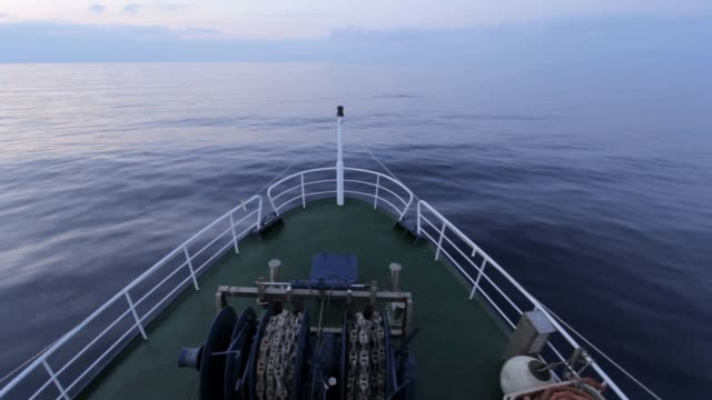the prow of a boat in navigation with a flat sea - ship's bow stock videos and b-roll footage