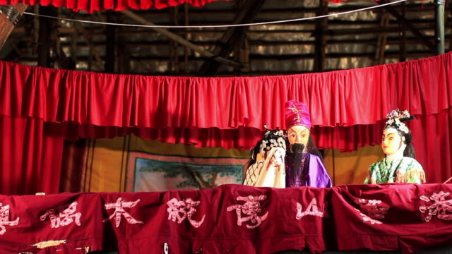 the puppet show is part of the once in a ten years festival, which is a tradition of this village to expel evil and pray for longevity. - puppet stock videos & royalty-free footage
