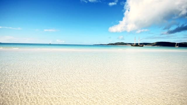 the pure blue water of whitsunday beach - panoramic stock videos & royalty-free footage