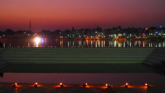 The Pushkar lake front during the festival is illuminated with lights and people are celebrating with fireworks in Rajasthan, India