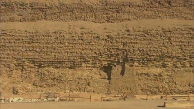 the pyramid of djoser is a step pyramid at saqqara, giza, egypt. - saqqara stock videos and b-roll footage
