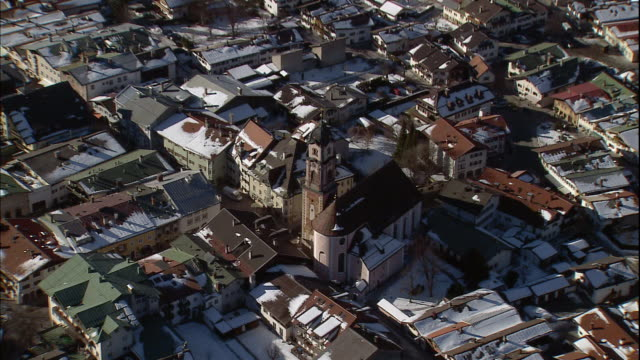 stockvideo's en b-roll-footage met the quaint town of garmisch-partenkirchen nestles in a valley in the german alps, bavaria, germany. - bavarian alps
