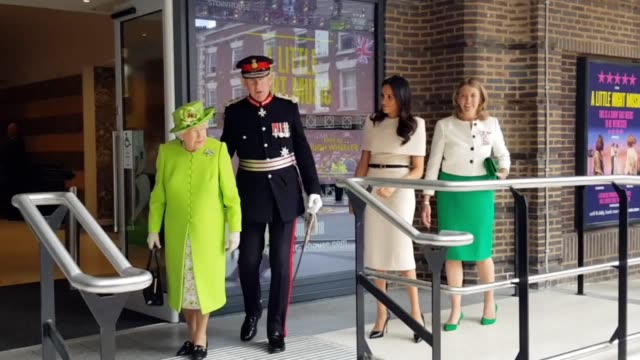 The Queen and Duchess of Sussex observe a minute's silence on their royal visit to Cheshire to remember those lost in the Grenfell Tower fire one...