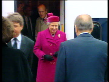 the queen and duke of edinburgh alighting eurostar train and shaking hands with president francois mitterand of france; opening of the channel... - eurotunnel folkestone stock-videos und b-roll-filmmaterial
