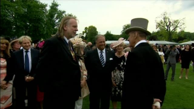 The Queen and Duke of Edinburgh host first garden party of the season Duke meeting Rick Wakeman / Princess Beatrice chatting