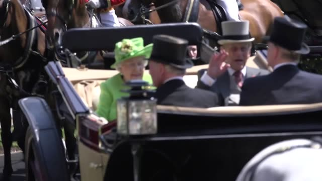 The Queen and Duke of Edinburgh lead the way as the Royal family arrive in the parade ring at Ascot in carriages