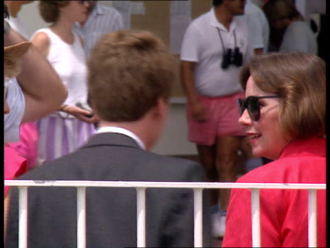 the queen and duke of edinburgh visit new zealand stadium seating / colin moynihan sports minister seen chatting to women / jockeys and horses... - limousine luxuswagen stock-videos und b-roll-filmmaterial