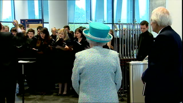 the queen and duke of edinburgh visit university of aberdeen; ***music heard sot** queen presented with gift / queen and prince philip watching choir - choir stock videos & royalty-free footage