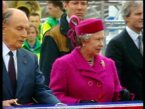 the queen and president francois mitterand of france taking scissors from ceremonial cushion and cutting ribbon to inaugurate channel tunnel opening... - la manica video stock e b–roll