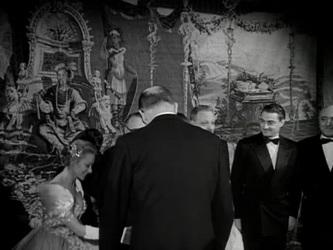 the queen and prince philip are introduced to various cast members of the film les belles de nuit at it's premiere 1953 - variation stock videos & royalty-free footage