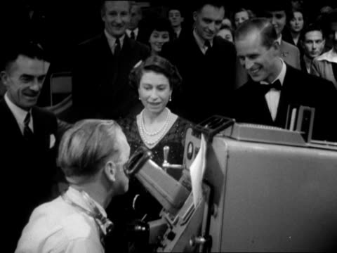 the queen and prince philip are shown how studio television cameras are operated during their visit to the bbc's lime grove studios. 1953. - peerage title stock videos & royalty-free footage