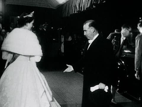the queen and prince philip arrive at the royal opera house accompanied by president lopes and his wife - formal stock videos & royalty-free footage