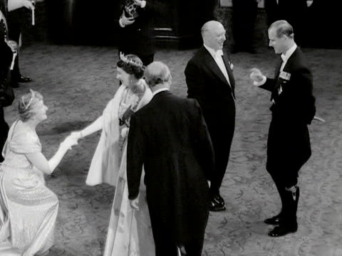 the queen and prince philip arrive at the royal opera house for the gala premiere of benjamin britten's new opera and greet the queen mother and... - dressing up stock videos & royalty-free footage