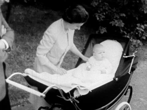 The Queen and Prince Philip check Prince Andrew in his pram in the grounds of Balmoral 1960