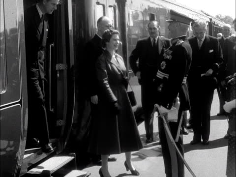 the queen and prince philip disembark the royal train at lanark station and are greeted by the lord lieutenant. 1953. - station stock videos & royalty-free footage