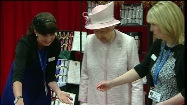 the queen and prince philip duke of edinburgh are on a two day tour of wales shows interior shots of the queen being shown stationary firm... - christmas cracker stock videos and b-roll footage