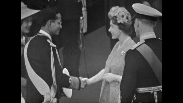 The Queen and Prince Philip greet King Bhumibol and Queen Srinagarindra as they arrive at Victoria Station