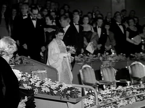 the queen and prince philip take their seats at a theatre for the premiere of the film les belles de nuit 1953 - dress stock videos & royalty-free footage