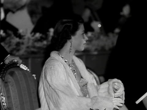 stockvideo's en b-roll-footage met the queen and prince philip take their seats at a theatre for the premiere of the film, les belles de nuit. 1953. - avondjurk