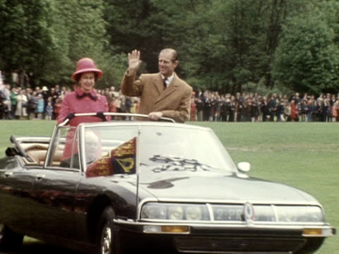 the queen and prince philip travel around the standard athletic club in meudon in an open topped car during their state visit to france 1972 - elizabeth ii stock videos & royalty-free footage
