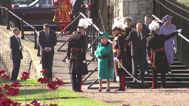 the queen and prince philip visit poppy memorial at the tower of london shows exterior shots queen elizabeth ii and prince philip being greeted by... - remembrance day stock videos & royalty-free footage